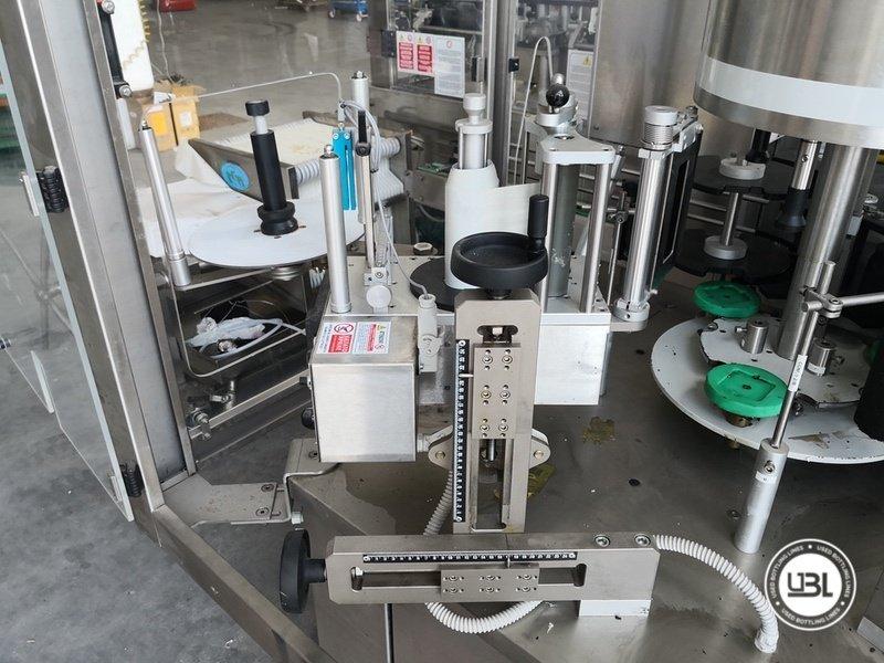 Used Bottle Labeler RCM 3T/2S/1cap 2500 bph year 2006 - 3