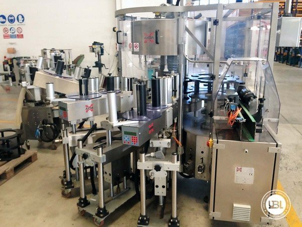 Used Bottle Labeler Axtra 720-H6-SA3 5000 bph year 2012 - 2