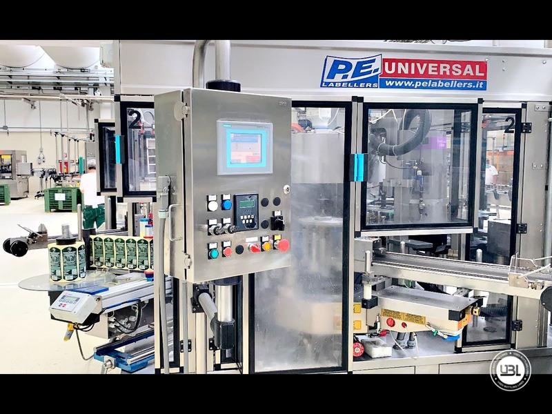 Etiquetadora automática rotativa usada P.E. Etiquetadoras modelo Universal Master 6000 bph año 2006 - 2